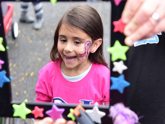 Julia Tomassi, 4, of Union Beach, checks out her face