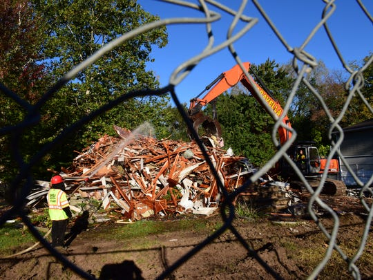 A home on Columbia Street in New Milford, whose owner opted for a buyout from the state Department of Environmental Protection Blue Acres program, was demolished in less than an hour on Tuesday.