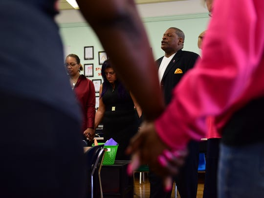 The Rev. Barry Graham, of Canaan Baptist Church, goes to PS 21 on Friday mornings to pray with teachers and staff before the school opens.