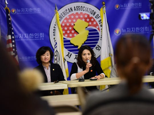 Eunju Hong, right, vice president of the Korean-American Association of Fort Lee, speaks at a news conference on Nov. 17 calling for the dismissal of a Bergen County Academies teacher who has been accused of making disparaging remarks in the classroom about Asian students.