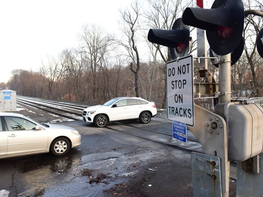 A railroad crossing on Brookside Avenue is under review and a proposal to close the steep road or make it one-way eastbound has been put off while police departments in Ho-Ho-Kus and Ridgewood attempt to improve driver safety.