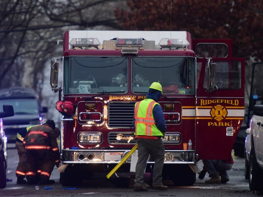 Ridgefield Park firefighters prepare to leave the fatal fire scene after the fire was out on Brinkerhoff St Wednesday February 07, 2018.