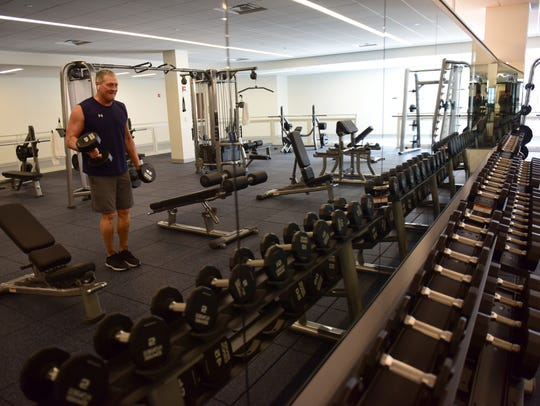 Steve Lellek, 56 of Mahwah, works out with free weights
