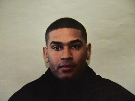 Paterson police officer Eudy Ramos is charged with extortion and conspiracy to deprive persons of their human rights.
