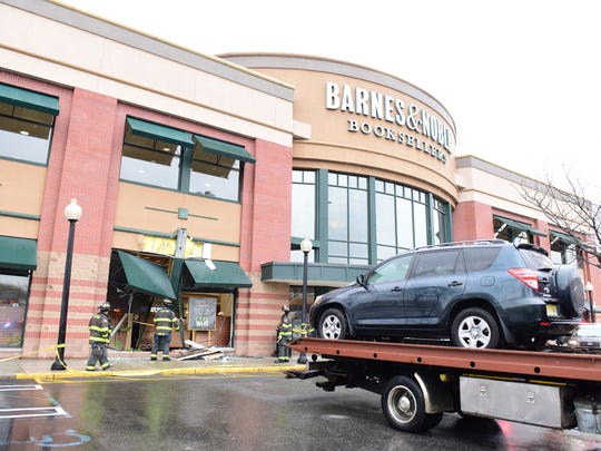 Clifton firefighters are at the scene of an SUV that crashed into the Barnes and Noble bookstore on Route 3 in Clifton on Thursday April 19, 2018.