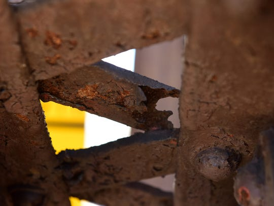 Rusted supports on the railroad bridge at the Garfield Train Station at Passaic Street in Garfield on Thursday April 26, 2018.