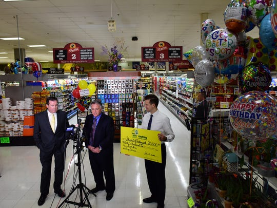 From left, John White, NJ Lottery acting executive director, presents a ceremonial check of $30,000 to Carl Inserra, Jr., and Lawrence Inserra, Jr., owners of Shoprite in Hackensack for selling the winning Powerball ticket of $315M in Hackensack on Monday May 21, 2018.