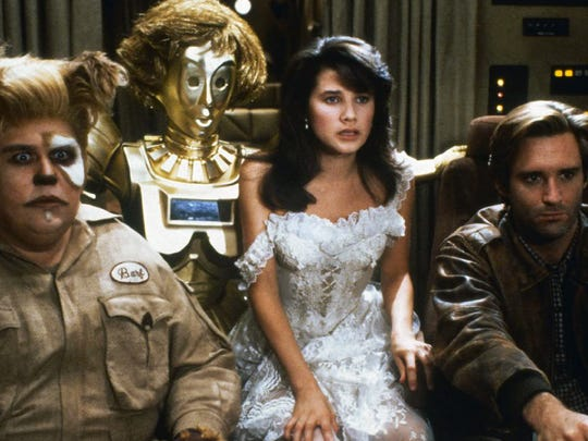 John Candy (from left), Daphne Zuniga and Bill Pullman in a scene from the 1987 Mel Brooks film 'Spaceballs.'