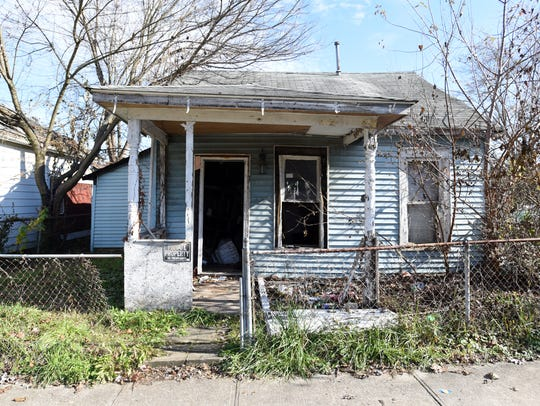 An abandoned property at 808 Woodlawn Ave. before it