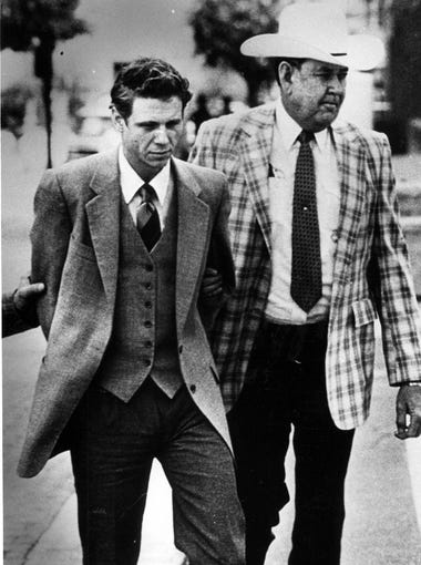 03/18/1988 David L. Wood, right, is escorted from the courthouse Thursday by Cecil Gutierrez, a jail transport officer.