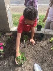 One student isn't afraid to get his hands dirty while
