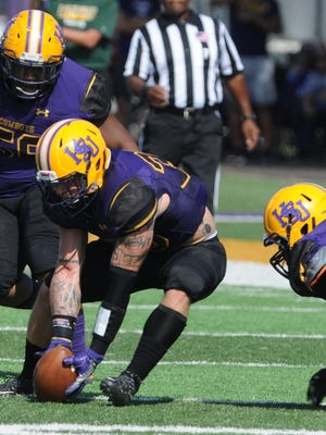 Hardin-Simmons linebacker Chris Miller picks up a fumble during last year's win against Belhaven. Miller is one of five team captains for the Cowboys this season as they open fall camp Thursday.