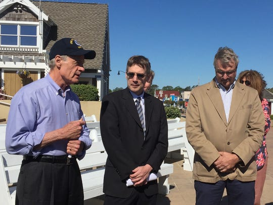 Sen. Tom Carper, left, announces beach nourishment