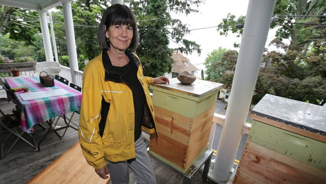 Marty Rosen, of Piermont, is pictured with her bee hives on her porch.