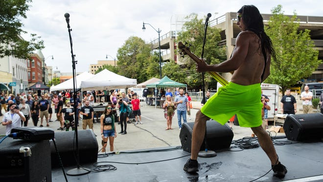 Johnny Tsakanikas performs with Foam Rangers during the Downhome Music Festival on July 28, 2018.