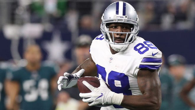 Dallas Cowboys wide receiver Dez Bryant (88) runs after a reception in the fourth quarter against the Philadelphia Eagles at AT&T Stadium.