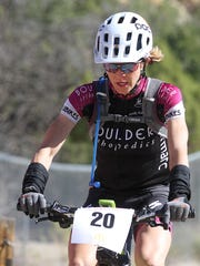 Angela Des Cognets of Golden, Colo., was the first woman to cross the finish line in the 30-mile course of the Road Apple Rally on Saturday at Lions Wilderness Park in Farmington.