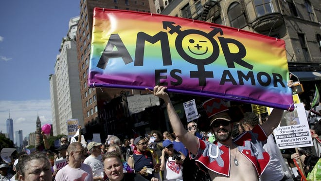 FILE - In this June 30, 2019, file photo, marchers participate in the Queer Liberation March in New York. This year's Pride events were supposed to be a blowout as LGBTQ people the world over marked the 50th anniversary of the first parade to celebrate what were then the initial small steps in their ability to live openly, and to advocate for bigger victories. Now, Pride is largely taking a backseat, having been driven to the internet by the coronavirus pandemic and now by calls for racial equality that were renewed by the killing of George Floyd in Minneapolis at the hands of police.