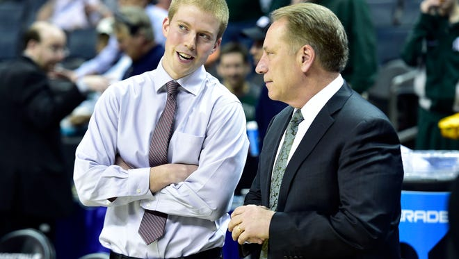 Mar 20, 2015; Charlotte, NC, USA; Michigan State Spartans head coach Tom Izzo (right) talks with his nephew Georgia Bulldogs operations coordinator Matt Bucklin before the game in the second round of the 2015 NCAA Tournament at Time Warner Cable Arena. Mandatory Credit: Bob Donnan-USA TODAY Sports