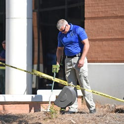 Law enforcement authorities are on the scene of a shooting outside the Madison County courthouse.