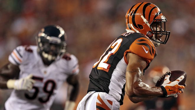 Cincinnati Bengals wide receiver Marvin Jones runs for the end zone on a touchdown reception in the second quarter of the Bengals' 21-10 victory over the Chicago Bears Saturday at Paul Brown Stadium.