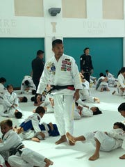 """Vince """"Bear"""" Quitugua, Shoyroll owner and organizer of Shoyoroll & Friends Event at the Guam Museum. The Brazilian Jiu-Jitsu open mat event brought star athletes to Guam to mentor young athletes."""