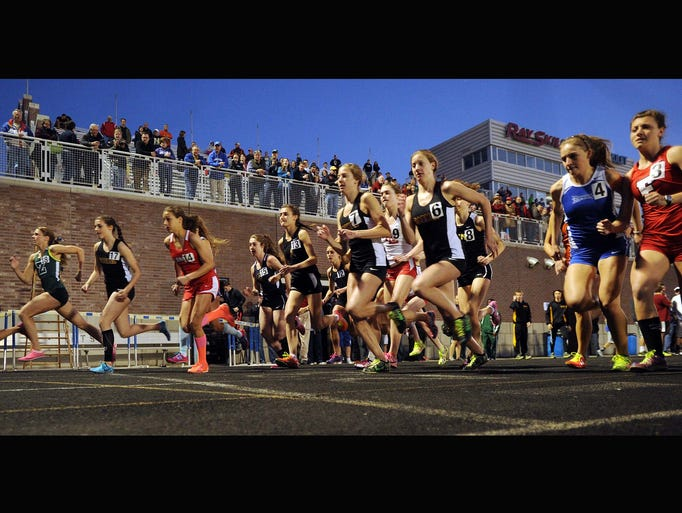 This is the start of the girls Miracle Mile during the annual Flashes Showcase Invitational track event at Franklin Central High School Friday April 18, 2014.