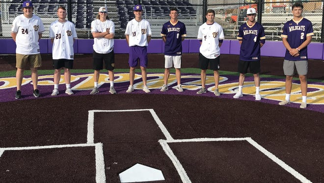 Senior members of the Blue Springs High School baseball team, who weren't able to play a game this spring because of the COVID-19 pandemic, gather at the high school Thursday night to be honored along with their parents. Seniors are, from left, Payton Schmidt, Ryan Eglich, Ethan Brooker, Colter Nelson, Tristan Stewart, Matt Eisenreich, Cade Bissell, Tanner Martin and Aiden Smith. The players were awarded a framed jersey and their mothers received flowers from coach Tim McElligott and the baseball booster club.