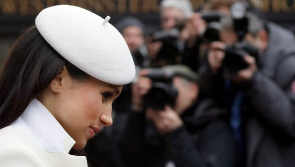 Media cameras focus on Meghan Markle as leaves Commonwealth