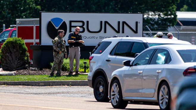 Law enforcement officers respond to the scene of an active shooter situation at the Bunn-O-Matic warehouse on Stevenson Drive on Friday.