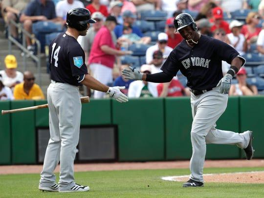 New York Yankees' Miguel Andujar, right, is met by