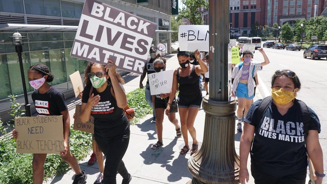 Rhode Island educators march from Burnside Park to the State House on Saturday to show support for Black Lives Matter and students of color.