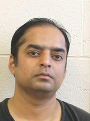 Friendly Food Store employee Mayank R. Kothari, 37.