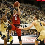 Feb 24, 2016; Pittsburgh, PA, USA; Louisville Cardinals guard David Levitch (23) drives to the basket against Pittsburgh Panthers forward Jamel Artis (1) during the first half at the Petersen Events Center. Mandatory Credit: Charles LeClaire-USA TODAY Sports