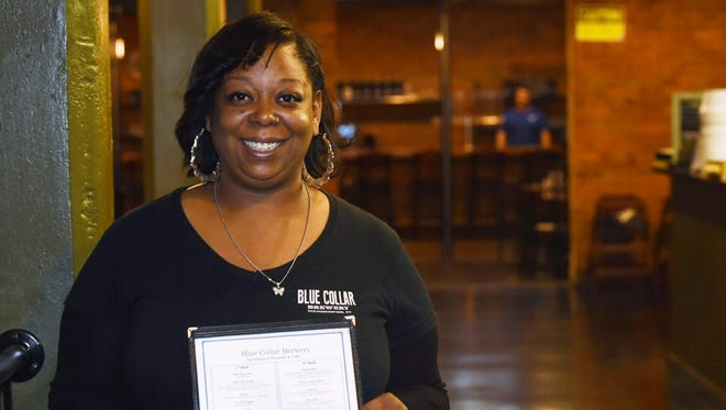 Shakira Freeman, a server at Blue Collar Brewery located in the City of Poughkeepsie., poses for a portrait.