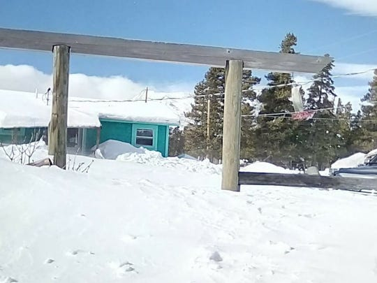 Snow drifts block in a home in East Glacier on the Blackfeet Indian Reservation