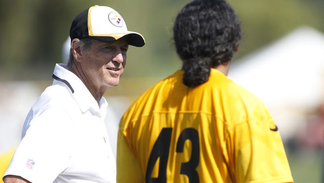 Jul 26, 2014; Latrobe, PA, USA; Pittsburgh Steelers defensive coordinator Dick LeBeau (left) and safety Troy Polamalu (43) talk during a break in drills during training camp at Saint Vincent College.