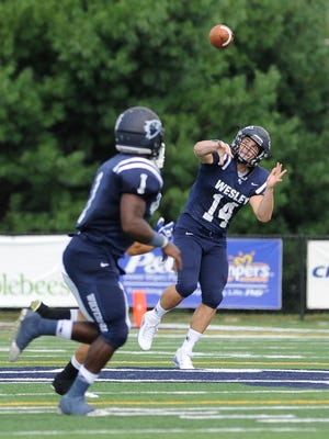 Wesley quarterback Joe Callahan with a pass to Will Poppe #1 in the first quarter against Christopher Newport University.