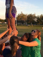 Fort Myers High School senior cheerleader and captain Kendall Watson, a 5.34 GPA IB student and Hillmyer Tremont Scholarship recipient, also coaches for the Cypress Lake Hornets youth cheer team, shown here at Rutenberg Park in Fort Myers.