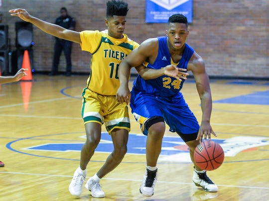 Crystal Springs' Roderick Smith (24) drives against Jim Hill during game action held at Murrah High School in Mississippi. (Bob Smith-For The Clarion Ledger)