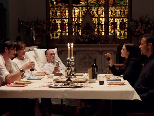 """A dying father (Richard Jenkins, center) takes in his final hours, and a final meal, with his family (Garrett Hedlund, left, Anne Archer, Jessica Brown Findlay and Daniel Sunjata)in """"Lullaby.""""<br /> """"It's about making good memories up until the end,"""" says writer/director Andrew Levitas. Here's a sneak peek of the film, which opens June 13."""