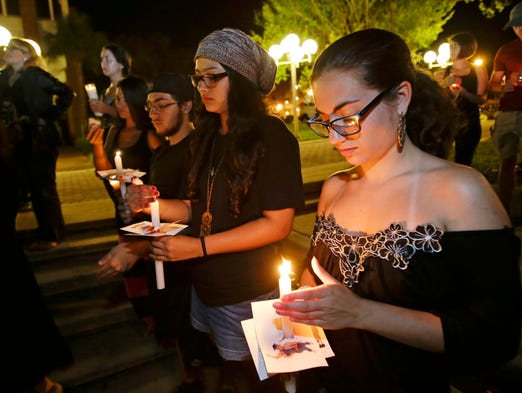 Students and supporters take part in a candle light vigil at the University of Central Florida in Orlando to honor Steven Sotloff, the second American journalist to be beheaded by the Islamic State group in two weeks. Sotloff attended the University of Central Florida between 2002 and 2004.