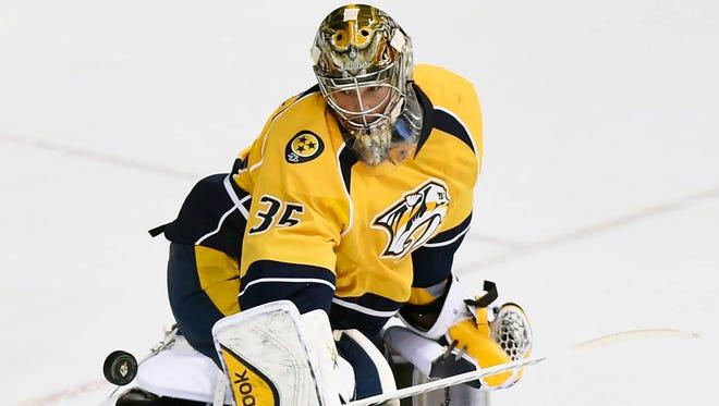 Predators goalie Pekka Rinne makes a save against the Buffalo Sabres on Saturday.