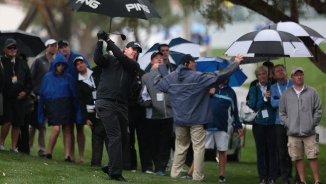 Phil Mickelson hits from the rough on hole 1 at La Quinta Country Club during the CareerBuilder ChallengeOn Thursday.