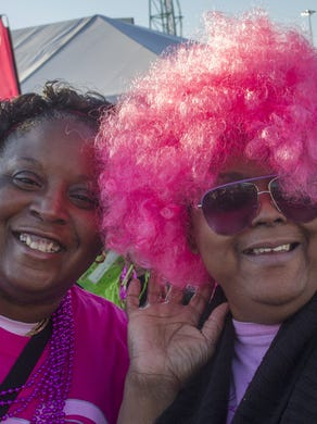 2014: Cancer Survivor Karen Sales of Cranford and friend Rochelle Manuel, of Metuchen clown around as the wait in line at one of the booths at the 21st Annual Susan G Komen Race For the Cure at Six Flags Great Adventure on October 5, 2014.