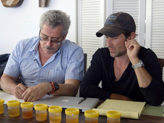 Russian scientist Grigory Rodchenkov, left, records urine samples from 'Icarus' filmmaker Bryan Fogel, who experimented with doping for his timely documentary.