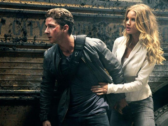 "Shia LaBeouf and Rosie Huntington-Whiteley in ""Transformers:"