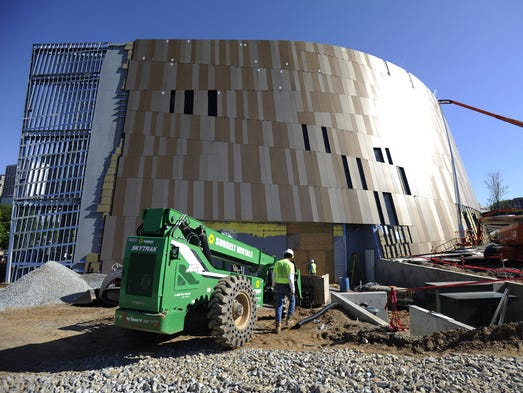 Construction crews work on the outside of the National Center for Civil and Human Rights.