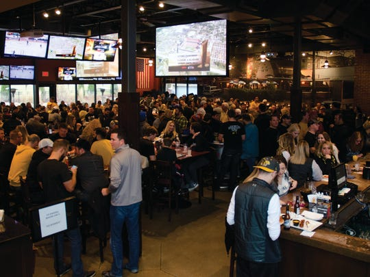 Hundreds of football fans packed in to watch the game at Wellman's Rooftop during the Outback Bowl game.
