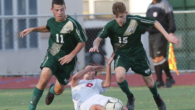 Vestal's Brian Salomons (11) and Carter Beaulieu (15) combine to steal the ball away from Somers Lucas Fecci (6) during the boys soccer regional semifinal  at Lakeland High School in Shrub Oak Nov. 2, 2016.